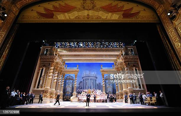 Russia's President Dmitry Medvedev stands with members of the Bolshoi Theatre company at the stage of the theatre in Moscow on September 20 2011...
