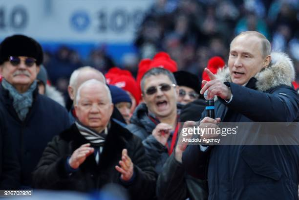 Russia's President Vladimir Putin addresses a rally in his support at the Luzhniki Stadium ahead of the 2018 Russian presidential election scheduled...
