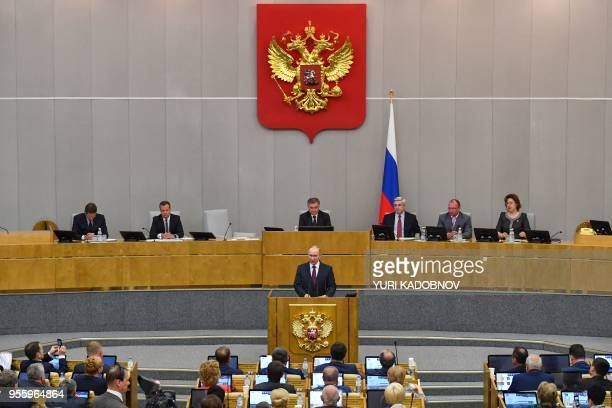 Russia's President Vladimir Putin and acting Prime Minister Dmitry Medvedev attend a session of the State Duma in Moscow on May 8 2018 Russia's lower...
