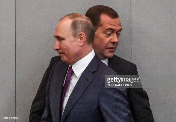 Russia's President Vladimir Putin and acting Prime Minister Dmitry Medvedev attend a session of the State Duma in Moscow on May 8 2018 The Russian...