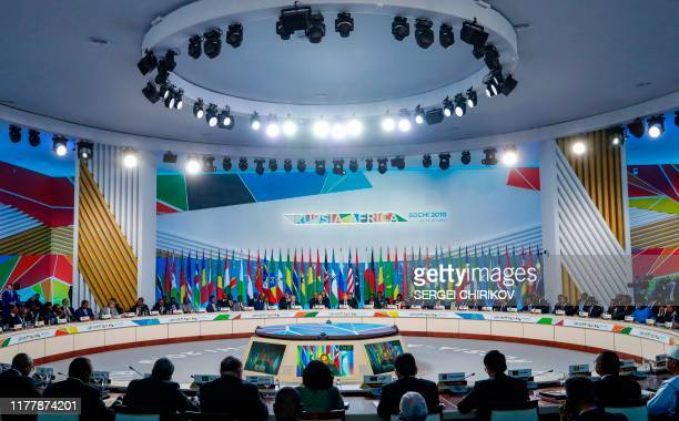 Russia's President Vladimir Putin and African countries leaders attend the first plenary session as part of the 2019 RussiaAfrica Summit at the...