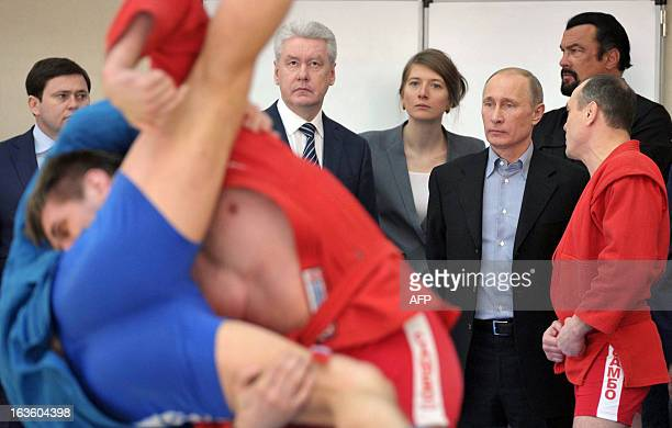 Russia's President Vladimir Putin and American action movie actor Steven Seagal visit a newlybuilt sports complex of Sambo70 prominent wrestling...