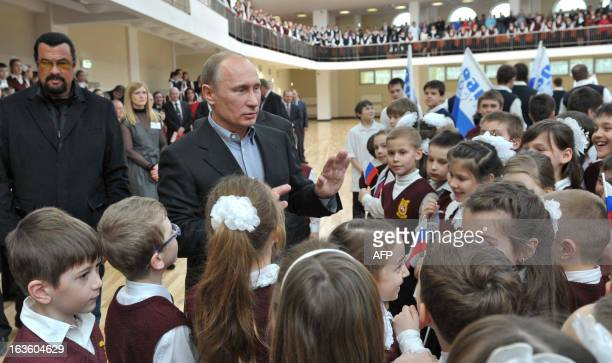 Russia's President Vladimir Putin and American action movie actor Steven Seagal meet children as they visit a newlybuilt sports complex of Sambo70...