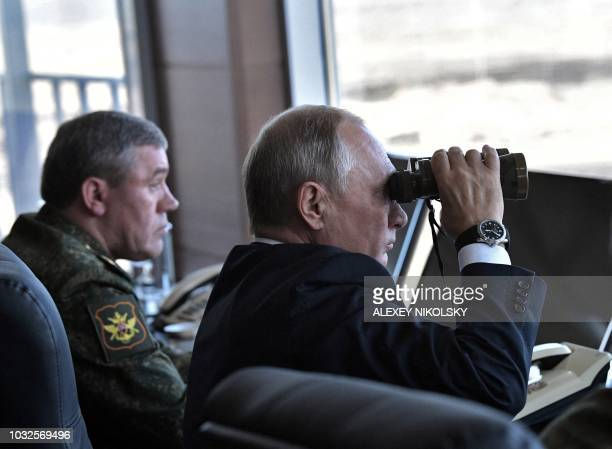 Russia's President Vladimir Putin and Chief of the General Staff of the Russian Armed Forces Valery Gerasimov watch the Vostok2018 military drills at...