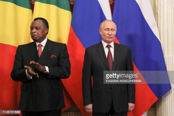 Russia's President Vladimir Putin and Congolese President Denis Sassou Nguesso attend a signing ceremony following their talks at the Kremlin in...