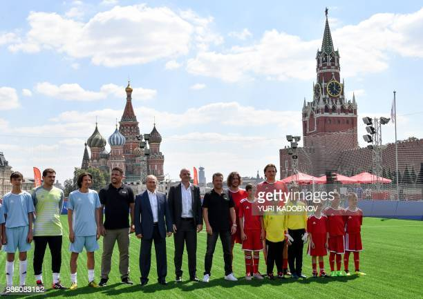 Russia's President Vladimir Putin and FIFA President Gianni Infantino pose for a picture with Russia's Football Union's antiracism inspector Alexei...