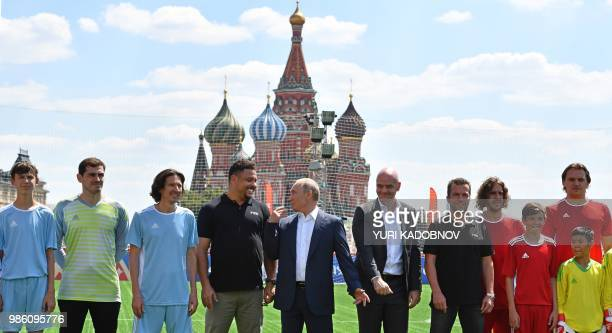 Russia's President Vladimir Putin and FIFA President Gianni Infantino pose for a picture with team members including Iker Casillas Russia's Football...