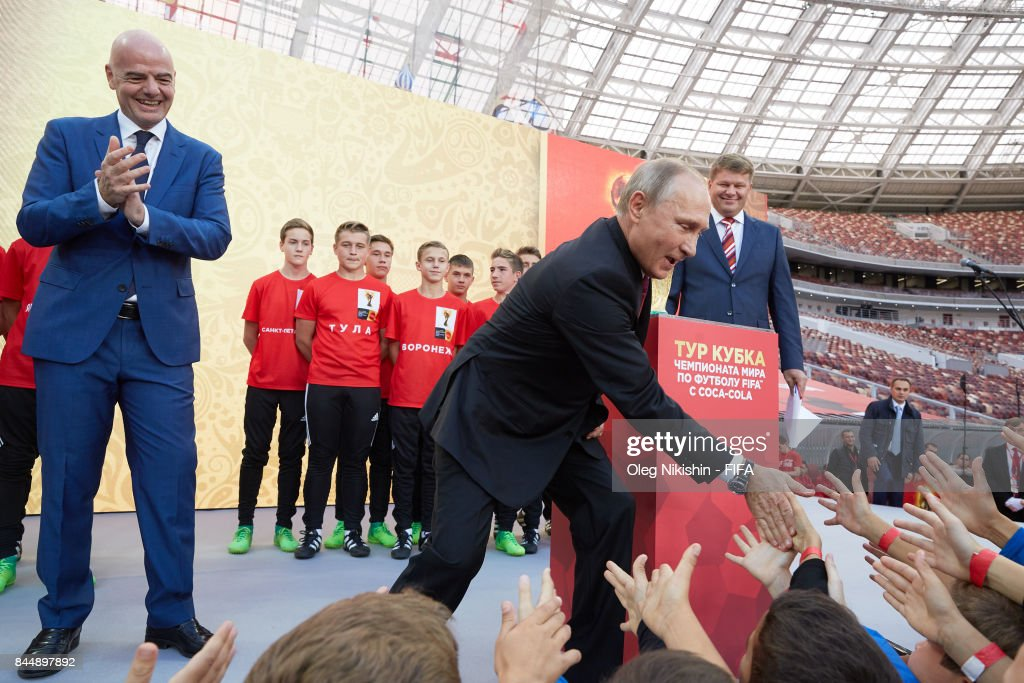 Russia's president Vladimir Putin and FIFA President GianniInfantino say goodbye with young football players during FIFA World Cup Trophy Tour at Luzhniki stadium on September 9, 2017 in Moscow, Russia.