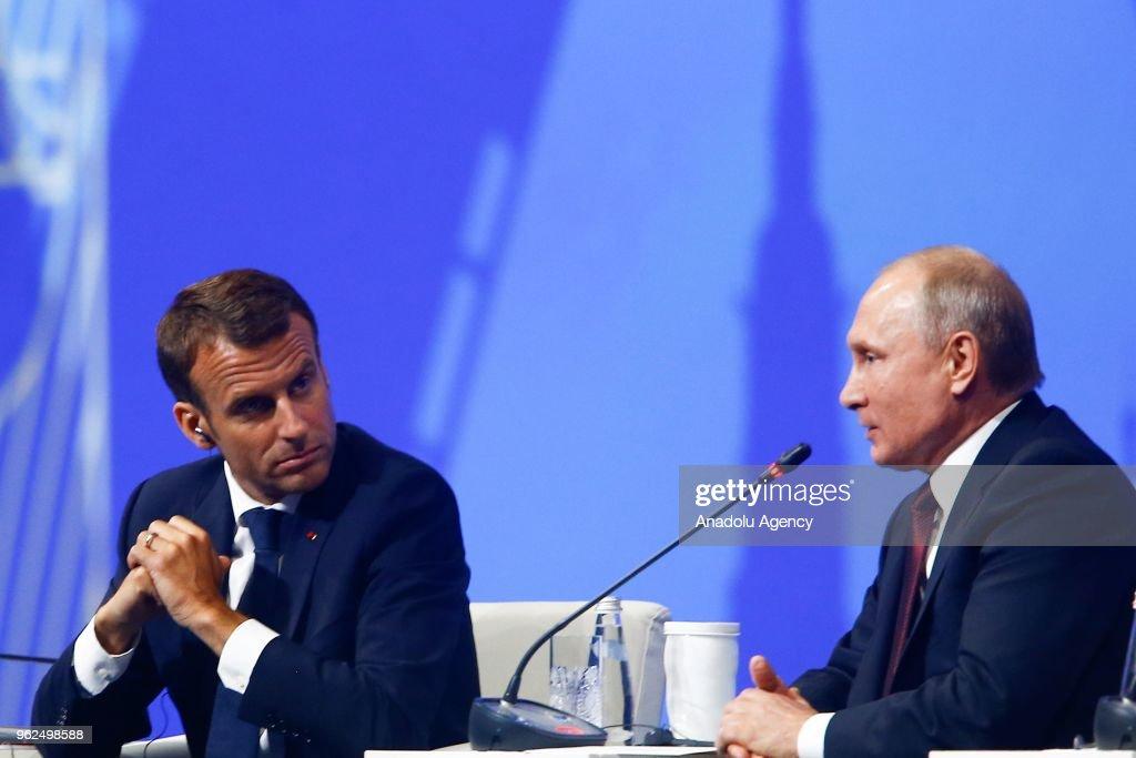 Russia's President Vladimir Putin (R) and France's President Emmanuel Macron (L) attend the 2018 St Petersburg International Economic Forum in Saint Petersburg, Russia on May 25, 2018.