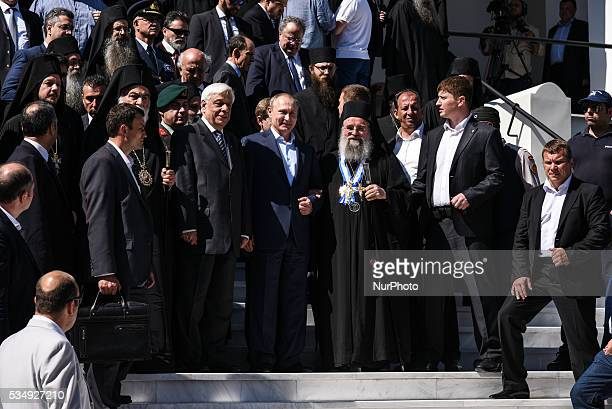 Russia's President Vladimir Putin and Greece's president Prokopis Pavlopoulos pose during a visit to the monastic community of Mount Athos in Karyes...