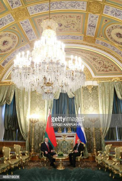 Russia's President Vladimir Putin and his Belarus' counterpart Alexander Lukashenko attend a meeting part of a session of the Supreme State Council...