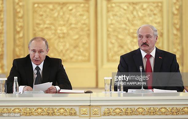 Russia's President Vladimir Putin and his Belarus' counterpart Alexander Lukashenko attend a session of the Supreme State Council of the Union State...