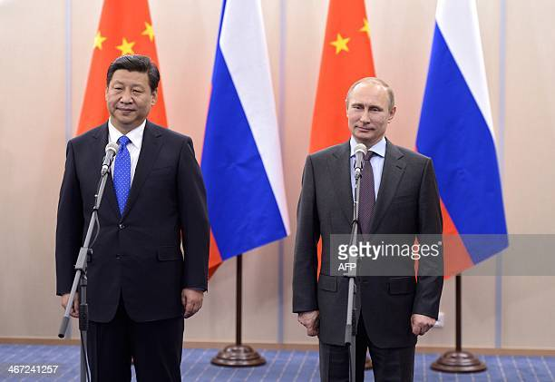 Russia's President Vladimir Putin and his Chinese couterpart Xi Jinping meet in the Russian Black Sea resort of Sochi on February 6 2014 Putin will...