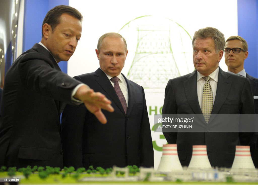 Russia's President Vladimir Putin (2nd L) and his Finnish counterpart Sauli Niinisto (2nd R) listen to Alexander Chuvaev (L), Executive Vice-President and President of Russian Division of Fortum Corporation, as they take part in ceremony to launch a Fortum Corporation's power plant in Nyagan, in western Siberia, on September 24, 2013.
