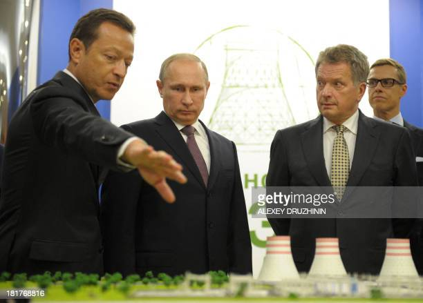 Russia's President Vladimir Putin and his Finnish counterpart Sauli Niinisto listen to Alexander Chuvaev Executive VicePresident and President of...