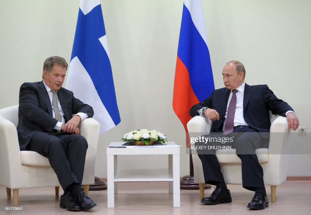 Russia's President Vladimir Putin (R) and his Finnish counterpart Sauli Niinisto (L) speak during their meeting in Nyagan, in western Siberia, on September 24, 2013.