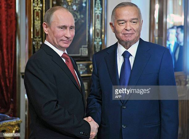 Russia's President Vladimir Putin and his Uzbek counterpart Islam Karimov shake hands during their meeting in the Kremlin in Moscow on April 15 2013...