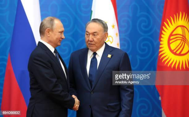 Russia's President Vladimir Putin and Kazakhstan's President Nursultan Nazarbayev shake their hands ahead of a meeting of the Shanghai Cooperation...