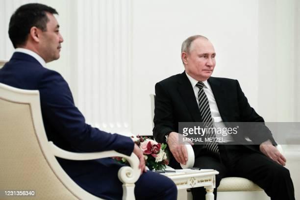 Russia's President Vladimir Putin and Kyrgyzstan's President Sadyr Japarov meet at the Kremlin, in Moscow, on February 24, 2021.