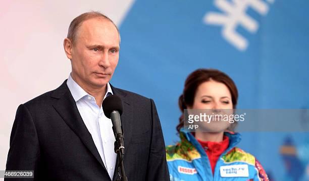 Russia's President Vladimir Putin and Olympic Village ViceMayor Russian figure skating star Irina Slutskaya attend a ceremony as they visit the...