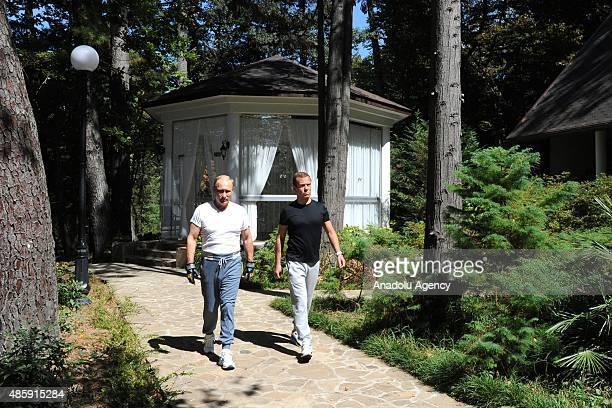 Russia's President Vladimir Putin and Prime Minister Dmitry Medvedev are seen at Bocharov Ruchei residence in Sochi, Russia on August 30,2015.