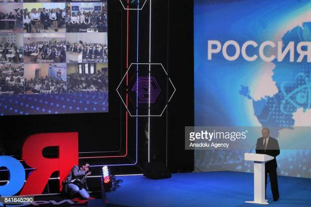 Russia's president Vladimir Putin and Russian teenagers attend at the AllRussian career guidance forum 'Proektoria' at the Arena 2000 recreation and...
