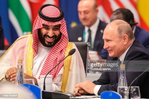 Russia's President Vladimir Putin and Saudi Arabia's Crown Prince Mohammed bin Salman attend the G20 Leaders' Summit in Buenos Aires on November 30...