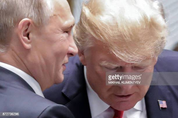 Russia's President Vladimir Putin and US President Donald Trump talk as they attend the AsiaPacific Economic Cooperation leaders' summit in the...