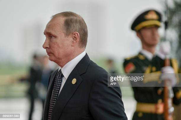 Russia's President Vladimir Putin arrives at the Hangzhou International Expo Center to attend the G20 Summit in Hangzhou on September 4, 2016. World...
