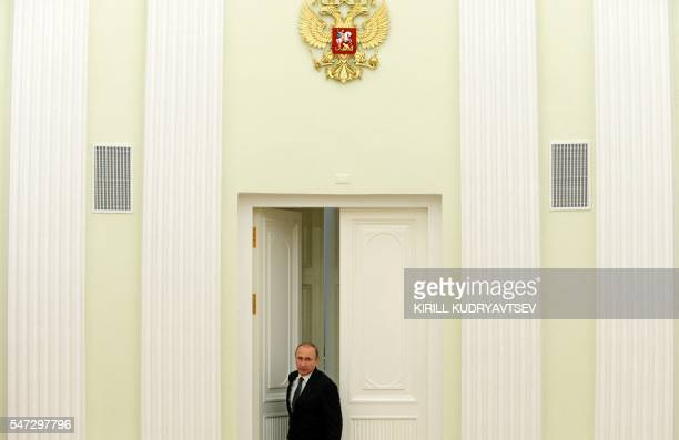 Russia's President Vladimir Putin arrives for a meeting with leaders of Russian State Duma fractions at the Kremlin in Moscow on July 14 2016 / AFP /...