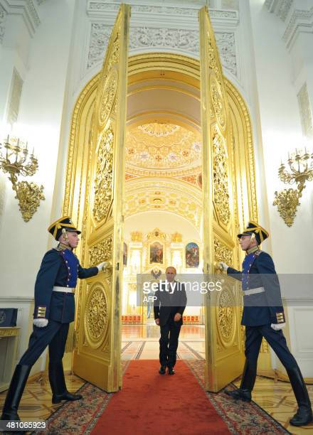 Russia's President Vladimir Putin arrives for a meeting with the newly promoted top officers from various branches of the Russian armed forces and...