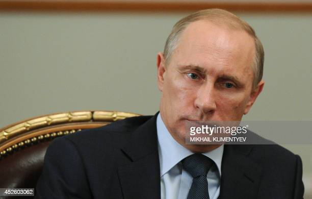 Russia's President Vladimir Putin attends a meeting in his NovoOgaryovo residence outside Moscow on July 24 2014 Putin is staring down fresh European...