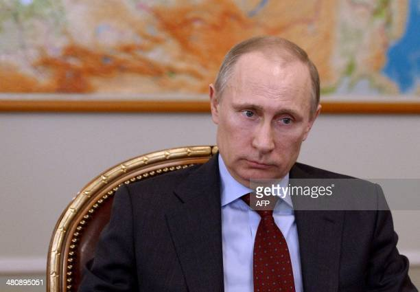 Russia's President Vladimir Putin attends a meeting in his NovoOgaryovo residence outside Moscow on March 27 2014 Putin said today Russia should...