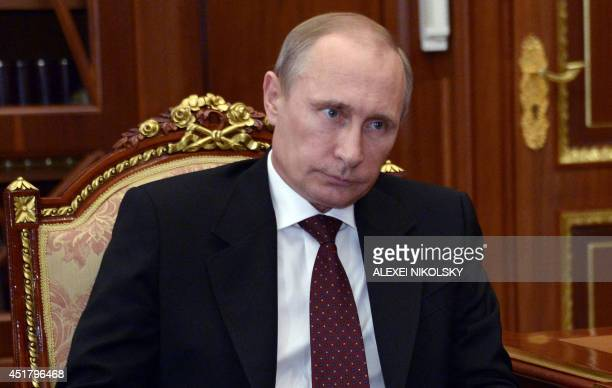 Russia's President Vladimir Putin attends a meeting in the Kremlin in Moscow, on July 7, 2014. Retreating pro-Russian insurgents dug in today in...