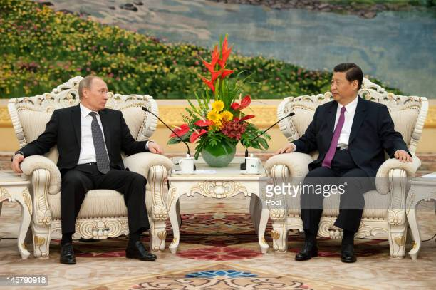 Russia's President Vladimir Putin attends a meeting with China's Vice President Xi Jinping prior to a meeting at the Shanghai Cooperation...