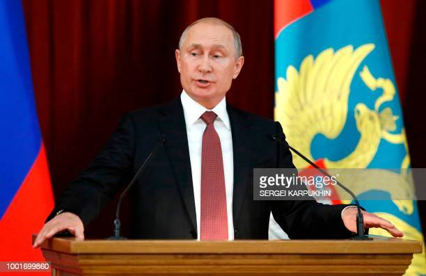 TOPSHOT Russia's President Vladimir Putin attends a meeting with Russian ambassadors and representatives to international organisations in Moscow on...
