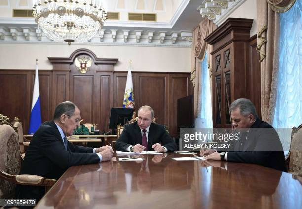 Russia's President Vladimir Putin attends a meeting with Russia's Foreign Minister Sergei Lavrov and Defence Minister Sergei Shoigu in Moscow on...