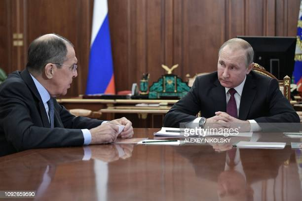 Russia's President Vladimir Putin attends a meeting with Russia's Foreign Minister Sergei Lavrov and Russia's Defence Minister in Moscow on February...