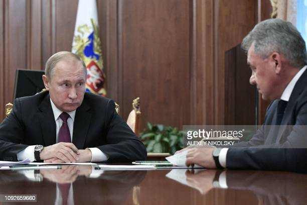 Russia's President Vladimir Putin attends a meeting with Russia's Defence Minister Sergei Shoigu and Russia's Foreign Minister in Moscow on February...