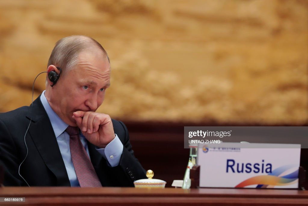 Russia's President Vladimir Putin attends the Roundtable Summit Phase One Sessions during the Belt and Road Forum, at the International Conference Center in Yanqi Lake, north of Beijing, on May 15, 2017. Chinese President Xi Jinping urged world leaders to reject protectionism on May 15 at a summit positioning Beijing as a champion of globalisation, as some countries raised concerns over his trade ambitions. / AFP PHOTO / POOL / Lintao Zhang