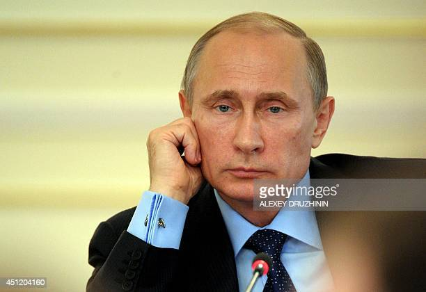 Russia's President Vladimir Putin chairs a Cabinet meeting in his NovoOgaryovo residence outside Moscow on June 25 2014 Ukraine's new Westernbacked...