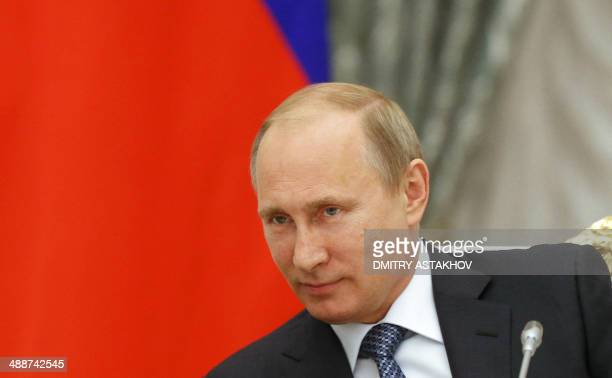 Russia's President Vladimir Putin chairs a meeting at the Kremlin in Moscow on May 7 2014 Putin told yesteday rebels in Ukraine to halt plans for...
