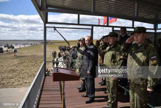 Russia's President Vladimir Putin China's Defense Minister Wei Fenghe Russian Defence Minister Sergei Shoigu and Chief of the General Staff of the...