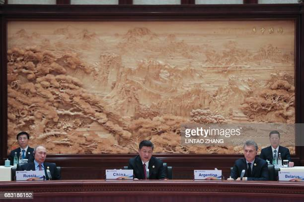 Russia's President Vladimir Putin Chinese President Xi Jinping and Argentinian President Mauricio Macri attend the Roundtable Summit Phase One...
