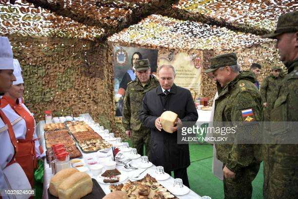 Russia's President Vladimir Putin Defence Minister Sergei Shoigu and Chief of the General Staff of the Russian Armed Forces Valery Gerasimov visit...
