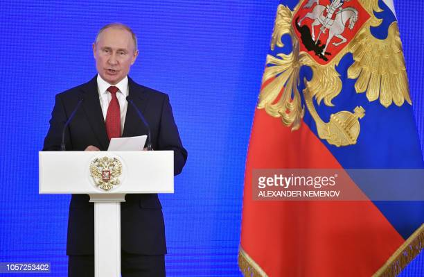 Russia's President Vladimir Putin delivers a speech during a reception in Moscow on November 4 as a part of celebrations marking Russian National...