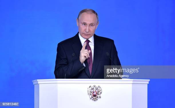Russia's President Vladimir Putin delivers an annual address to the Federal Assembly of the Russian Federation at Moscow's Manezh Central Exhibition...