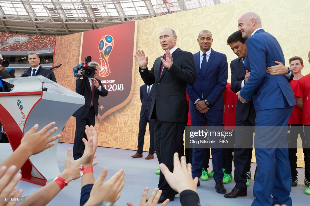 Russia's president Vladimir Putin, FIFA Legends David Trezeguetand, Bebeto and FIFA President GianniInfantino say goodbye with young football players during FIFA World Cup Trophy Tour at Luzhniki stadium on September 9, 2017 in Moscow, Russia.