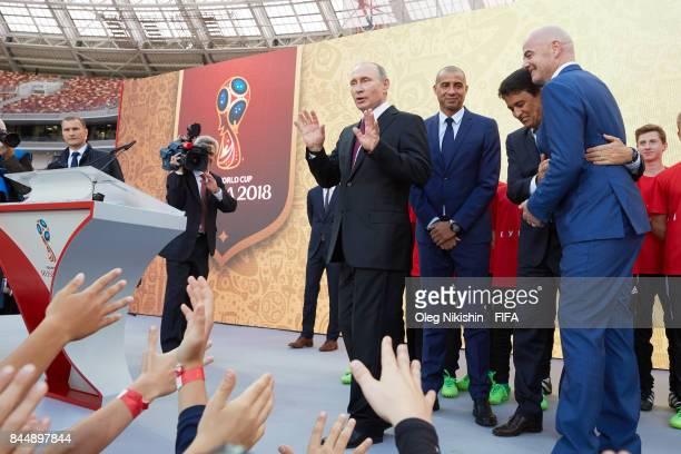Russia's president Vladimir Putin FIFA Legends David Trezeguetand Bebeto and FIFA President GianniInfantino say goodbye with young football players...