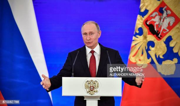 Russia's President Vladimir Putin gestures as he delivers a speech during a reception in Moscow on November 4 as a part of celebrations marking...